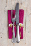 Cutlery - fork and knife on purple napkin Royalty Free Stock Images