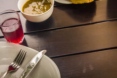 Cutlery fork and knife on a white plate Royalty Free Stock Images