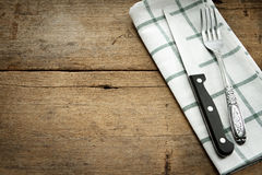 Cutlery and fork with napery  on wooden background. Stock Photography