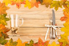 Cutlery and glass for mulled wine in the frame made from maple l Stock Photo
