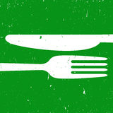 Cutlery on green background Stock Photography