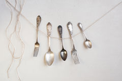 Cutlery hang on the string. Silver cutlery hang on the string Stock Images