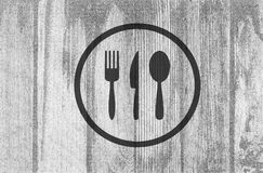 Cutlery icons on planked wood background Royalty Free Stock Photo