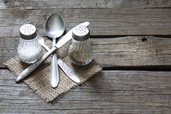 Cutlery kitchenware on old wooden boards background Royalty Free Stock Image