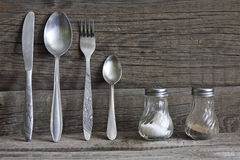 Cutlery kitchenware on old wooden boards background Stock Image