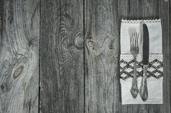 Cutlery knife and fork on gray wooden surface Royalty Free Stock Images