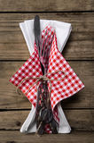 Cutlery with knife and fork plus a napkin in red white checked c Stock Photography