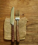 Cutlery (knife and fork) on wooden Stock Photo