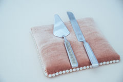 Cutlery - knife on o pillow. Silver cutlery, knife encrusted on a pillow Royalty Free Stock Photos