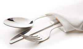 Cutlery. Knife, spoon and fork tied ribbon royalty free stock photos