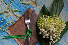 Cutlery and lilies of the valley Stock Images