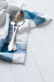 Cutlery and linen napkin Royalty Free Stock Images
