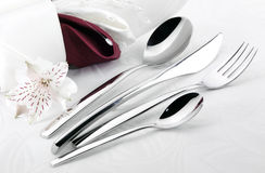 Cutlery with linen serviette Stock Photo