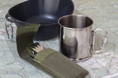 Cutlery and mug on map. Cutlery and mug on paper map Stock Photo