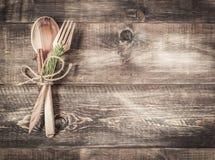 Cutlery na drewnianym tle Zdjęcia Stock