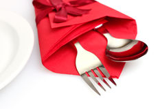 Cutlery and napkin. Isolated on white Stock Images