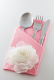 Cutlery and Napkin. With flower decoration Royalty Free Stock Photography