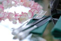 Cutlery on a napkin on a mirror table royalty free stock photography