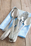 Cutlery with napkin. Old cutlery with napkin on a table Royalty Free Stock Photography
