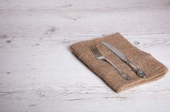 Cutlery is in a napkin wrapped on an old. Table Stock Image