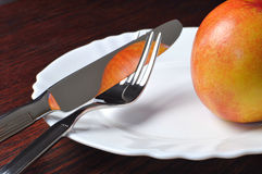 Cutlery and nectarine Stock Photos