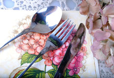Cutlery. Old cutlery on a printed napkin royalty free stock photography