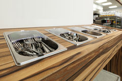 Cutlery output in self service restaurant Royalty Free Stock Photography