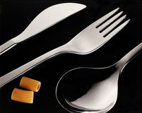 Cutlery with pasta. On black table Royalty Free Stock Photography