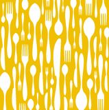 Cutlery pattern on yellow background Stock Photo