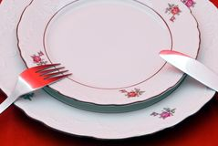 Cutlery on plate Royalty Free Stock Photos