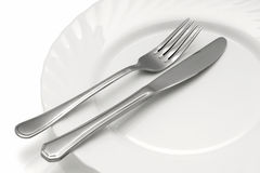 Cutlery on a plate. Stock Image