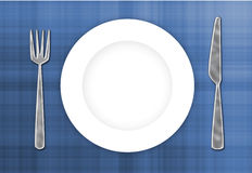Cutlery & Plate. Stainless steel cutlery and white plate ready for your dessert royalty free stock photo