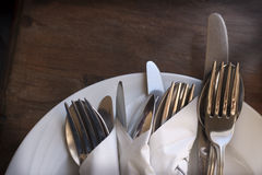 Cutlery on plate Stock Photo