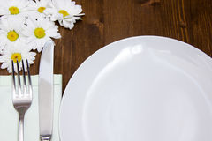 Cutlery and plate with flowers close up Stock Photo