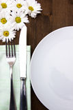 Cutlery and plate with flowers Stock Photography
