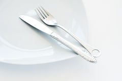 Cutlery. Plate with Fork and knife Royalty Free Stock Image