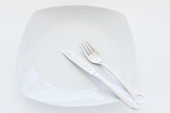 Cutlery. Plate with Fork and knife Stock Photos