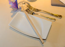 Cutlery and plate Stock Images