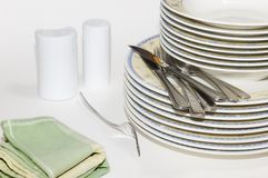 Cutlery and plates Stock Image