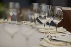 Cutlery, plates and glasses royalty free stock images
