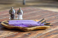 Cutlery in purple napkin. Hospitably prepared Cutlery in purple napkin with Salt und Pepper shaker Royalty Free Stock Photography