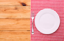 Cutlery red checkered tablecloth tartan on  wooden Royalty Free Stock Photos