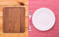 Cutlery red checkered tablecloth tartan on  wooden Stock Photos