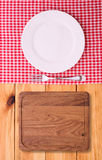 Cutlery red checkered tablecloth tartan on  wooden Royalty Free Stock Photo
