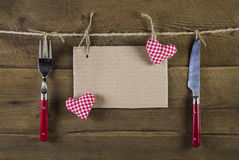 Cutlery in red color with empty advertising board and two red wh Stock Photography