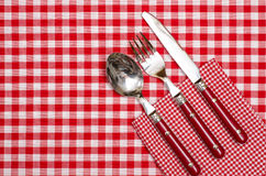 Cutlery with red knife, fork and spoon Stock Image