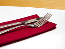 Cutlery on red napkin Stock Photography