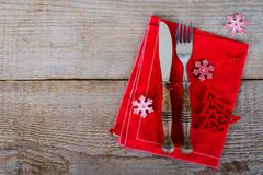 The cutlery on the red napkin. On wood Royalty Free Stock Photo