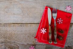 The cutlery on the red napkin. On wood Stock Photo