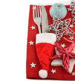 Cutlery and red napkin. On a white background Royalty Free Stock Image